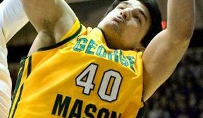 **FILE** James Madison's Enoch Hood, from left, George Mason's Jonathan Arledge, James Madison's Devon Moore and George Mason's Marko Gujanicic battle for possession during an NCAA college basketball game Saturday, Feb. 2, 2013, in Harrisonburg, Va. (AP Photo/The Daily News-Record, Nikki Fox)