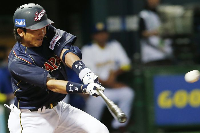 Japan's infielder Nobuhiro Matsuda hits an RBI single off Brazil's pitcher Kesley Kondo in the eighth inning of their World Baseball Classic first round game in Fukuoka, Japan, Saturday, March 2, 2013. (AP Photo/Koji Sasahara