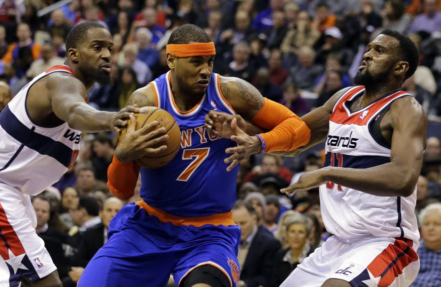 New York Knicks forward Carmelo Anthony (7) drives between Washington Wizards forwards Martell Webster (9) and Chris Singleton (31) in the first half of an NBA basketball game, Friday, March 1, 2013, in Washington. (AP Photo/Alex Brandon)