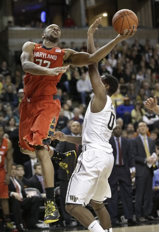 Maryland's Dez Wells (32) drives past Wake Forest's Codi Miller-McIntyre (0) during the second half of an NCAA college basketball game in Winston-Salem, N.C., Saturday, March 2, 2013. Maryland won 67-57. (AP Photo/Chuck Burton)