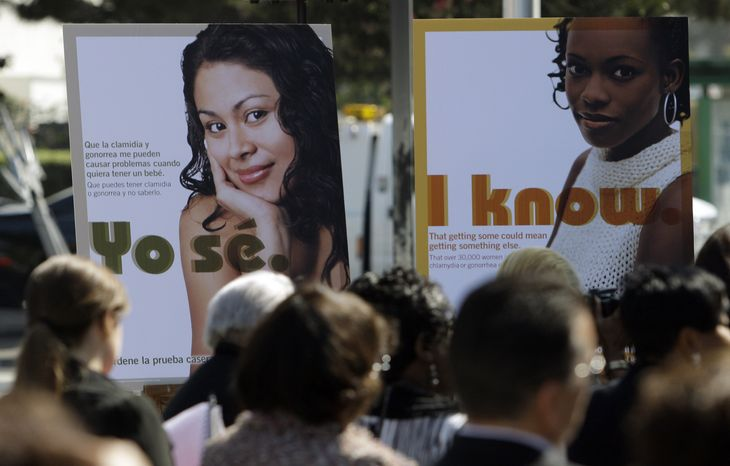 ** FILE ** Public service posters in English and Spanish are seen at a news conference to announce a Los Angeles County program to provide young women in South Los Angeles with home-testing kits for sexually transmitted diseases, at a news conference in the