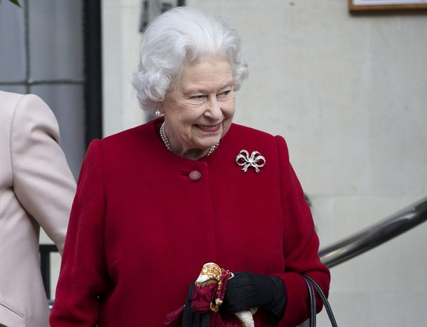 ** FILE ** Britain's Queen Elizabeth II leaves the King Edward VII Hospital in London on Monday, March 4, 2013, following a one-day stay caused by a stomach ailment. (AP Photo/Alastair Grant)