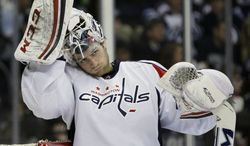 Washington Capitals goaltender Braden Holtby takes a break during second-period NHL hockey game action against the Winnipeg Jets in Winnipeg, Manitoba, Saturday, March 2, 2013. (AP Photo/The Canadian Press, John Woods)
