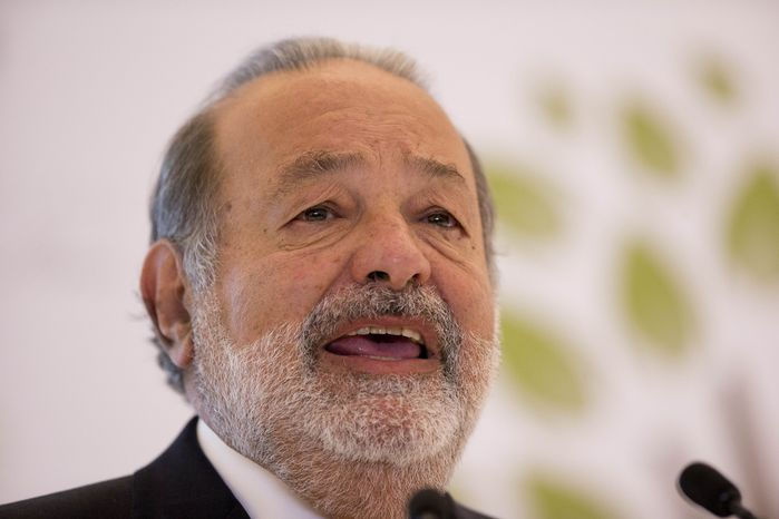 Mexican telecommunications tycoon Carlos Slim speaks during news conference at the Soumaya Museum in Mexico City on Monday, Jan. 14, 2013. Mr. Slim remains the world's richest man for the fourth year in a row, Forbes says, while Warren Buffett dropped out