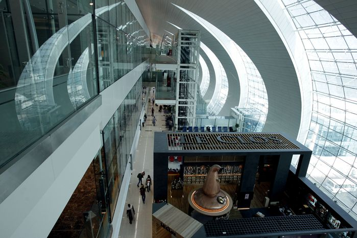 Passengers walk in the new Concourse A of Dubai International Airport in Dubai, United Arab Emirates, on Sunday, Feb. 10, 2013. (AP Photo/Kamran Jebrei