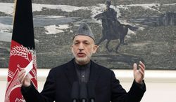 ** FILE ** In this Monday, Jan. 14, 2013, file photo, Afghan President Hamid Karzai speaks during a press conference at the presidential palace in Kabul, Afghanistan. (AP Photo/Ahmad Jamshid, File)
