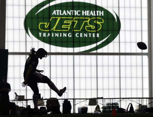Lauren Silberman boots the ball during kicker tryouts at an NFL football regional combine workout, Sunday, March 3, 2013, at the New York Jets'