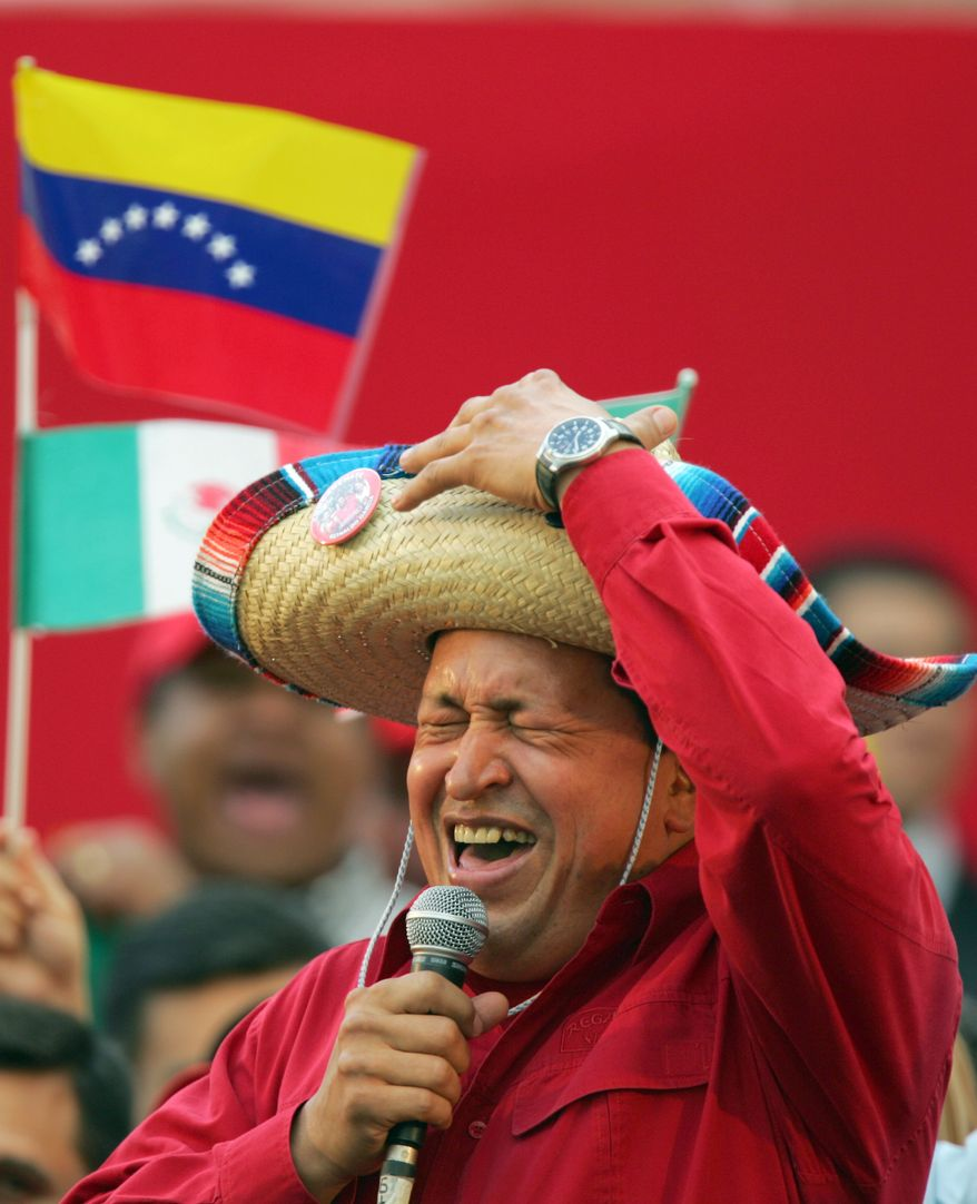 FILE - In this Nov. 19, 2005 file photo, Venezuela's President Hugo Chavez wears a Mexican sombrero as he sings a Mexican ranchera song at a rally in Caracas, Venezuela.  Venezuela's Vice President Nicolas Maduro announced on Tuesday, March 5, 2013 that President Hugo Chavez has died at age 58 after a nearly two-year bout with cancer. During more than 14 years in office, Chavez routinely challenged the status quo at home and internationally. He polarized Venezuelans with his confrontational and domineering style, yet was also a masterful communicator and strategist who tapped into Venezuelan nationalism to win broad support, particularly among the poor. (AP Photo/Fernando Llano, File)