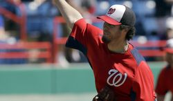 Washington Nationals pitcher Dan Haren throws against the Houston Astros during the first inning of an exhibition spring training baseball game Tuesday, March 5, 2013, in Viera, Fla. (AP Photo/David J. Phillip)