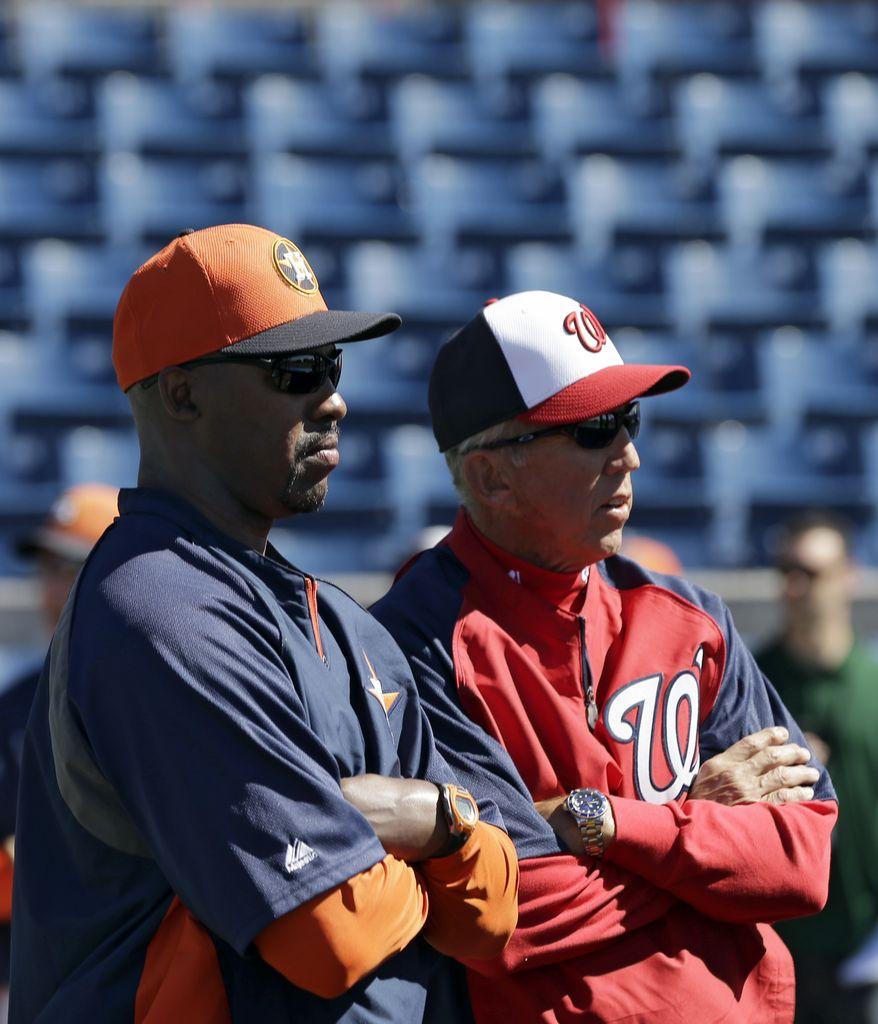 Washington Nationals manager Davey Johnson, right, and Houston Astros manager Bo Porter, left, watch batting practice before an exhibition spring training baseball game Tuesday, March 5, 2013, in Viera, Fla. (AP Photo/David J. Phillip)