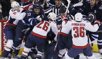 Winnipeg Jets and Washington Capitals mix it up after a play during third-period NHL hockey game action in Winnipeg, Manitoba, Saturday, March 2, 2013. (AP Photo/The Canadian Press, John Woods)