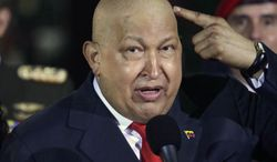 ** FILE **Venezuela's deceased president Hugo Chavez (AP Photo/Ariana Cubillos, file)