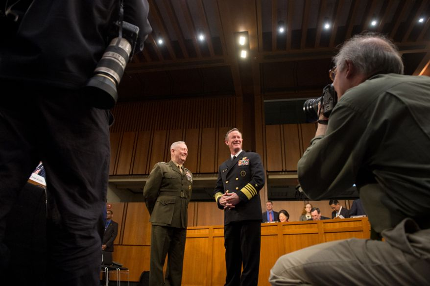 Marine Gen. James N. Mattis (left), commander of U.S. Central Command, and Adm. William H. McRaven (right), commander of the U.S. Special Operations Command, talk together on Capital Hill in Washington on Tuesday, March 5, 2013, before testifying before the Senate Armed Services Committee on a review of the defense authorization request for fiscal 2014 and future years. (Andrew Harnik/The Washington Times)