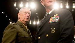 Marine Gen. James N. Mattis (left), commander of U.S. Central Command, and Adm. William H. McRaven (right), commander of the U.S. Special Operations Command, arrive on Capital Hill in Washington on Tuesday, March 5, 2013, to testify before the Senate Armed Services Committee on a review of the defense authorization request for fiscal 2014 and future years. (Andrew Harnik/The Washington Times)