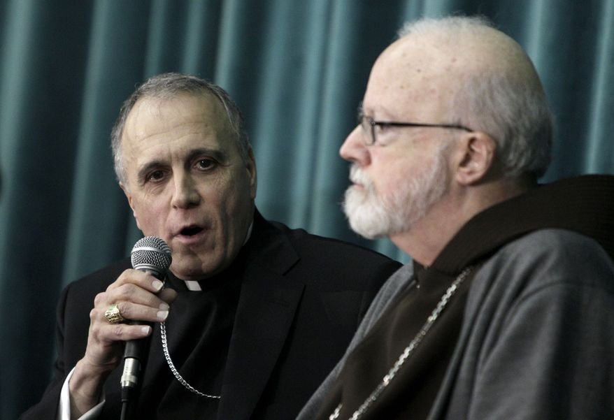 Cardinal Daniel DiNardo (left), archbishop of Galveston-Houston, and Cardinal Sean Patrick O'Malley, archbishop of Boston, attend a press conference at the Pontifical North American College in Rome on Tuesday, March 5, 2013. (AP Photo/Riccardo De Luca)