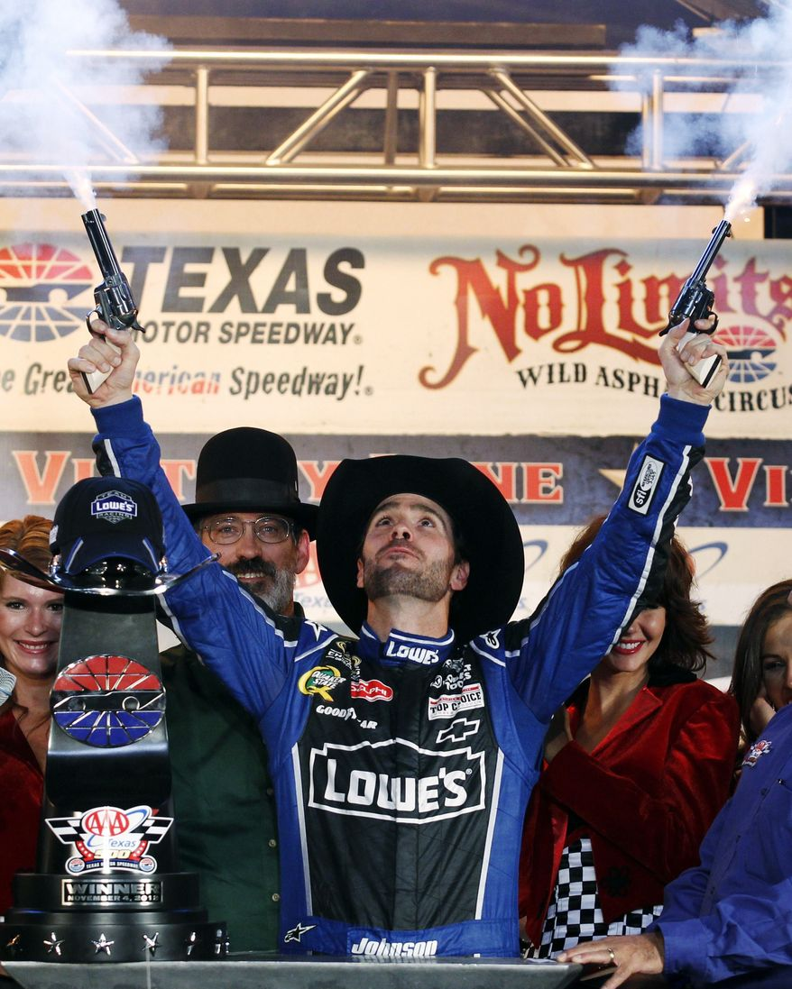 ** FILE ** In this Nov. 4, 2012, file photo, Jimmie Johnson fires blanks out of a pair of revolvers as he celebrates his win in Victory Lane following the NASCAR Sprint Cup Series auto race at Texas Motor Speedway, in Fort Worth, Texas. The National Rifle Association is taking its relationship with racing to a new level as the title sponsor of a NASCAR Sprint Cup Series race. (AP Photo/Tim Sharp, File)