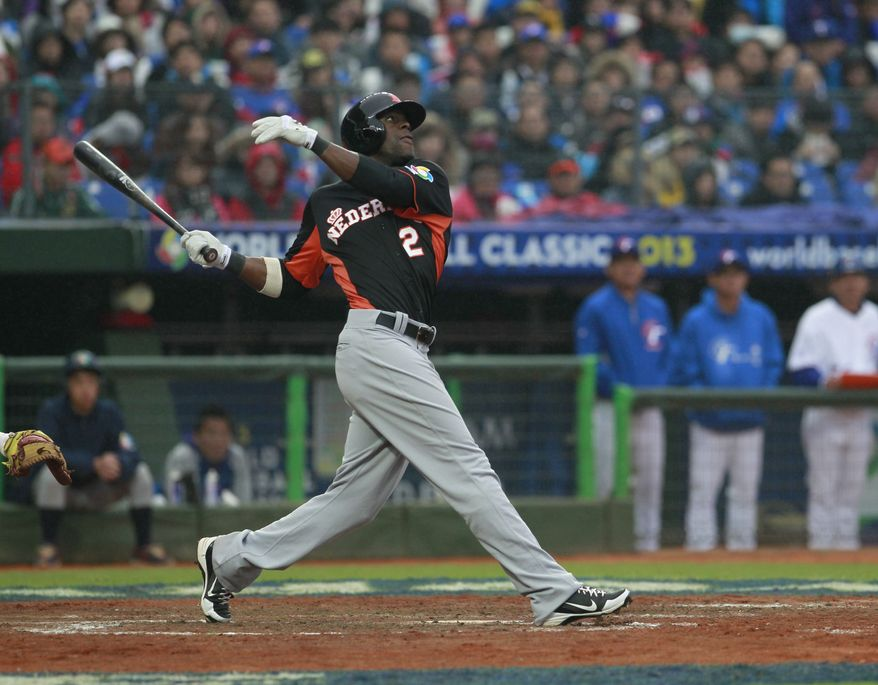 The Netherlands out fielder Roger Bernadina (2) follows a fly ball against Taiwan in the fifth inning of their World Baseball Classic second round game at the Intercontinental Baseball Stadium in Taichung, Taiwan, Sunday, March 3, 2013. Taiwan won 8-3. (AP Photo/Wally Santana)