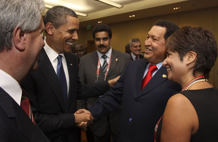 **FILE** President Obama (left) shakes hands with Venezuelan President Hugo Chavez before the opening session of the 5th Summit of the Americas in Port of S