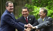 In this April 8, 2001, file photo, Mexico's then-President Vicente Fox, left, Venezuela's President Hugo Chavez, center, and Colombia's President Andres Pastrana shake hands as they pose for a photo in Caracas, Venezuela. (AP Photo/Fernando Llano, File)