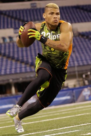 Louisiana State defensive back Tyrann Mathieu runs a drill during the NFL football scouting combine in Indianapolis, Tuesday, Feb. 26, 2013. (AP Photo/Dave Martin)