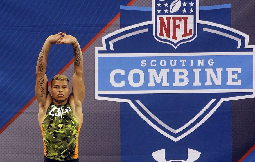 Louisiana State defensive back Tyrann Mathieu stretches before running the 40-yard dash during the NFL football scouting combine in Indianapolis, Tuesday, Feb. 26, 2013. (AP Photo/Dave Martin)