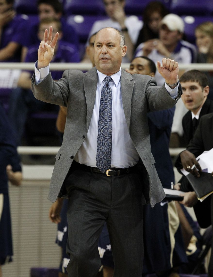 **FILE** Navy head coach Ed DeChellis instructs his team against TCU in the first half of an NCAA college basketball game Tuesday, Nov. 20, 2012, in Fort Worth, Texas. (AP Photo/Tony Gutierrez)