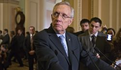 **FILE** Senate Majority Leader Harry Reid of Nevada pauses during a news conference on Capitol Hill in Washington on March 5, 2013, following a Democratic strategy session. (Associated Press)