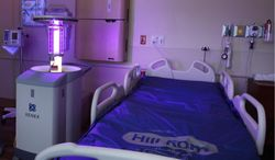 """** FILE ** The Xenex """"robot"""" uses pulse xenon to deliver UV light throughout patient rooms, operating rooms (ORs), equipment rooms, emergency rooms, intensive-care units (ICUs) and public areas to destroy viruses, bacteria and bacterial spores in just 5-10 minutes per room. (Photo: Business Wire)"""