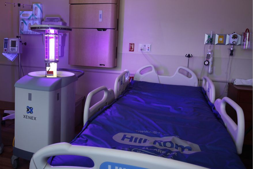 "** FILE ** The Xenex ""robot"" uses pulse xenon to deliver UV light throughout patient rooms, operating rooms (ORs), equipment rooms, emergency rooms, intensive-care units (ICUs) and public areas to destroy viruses, bacteria and bacterial spores in just 5-10 minutes per room. (Photo: Business Wire)"