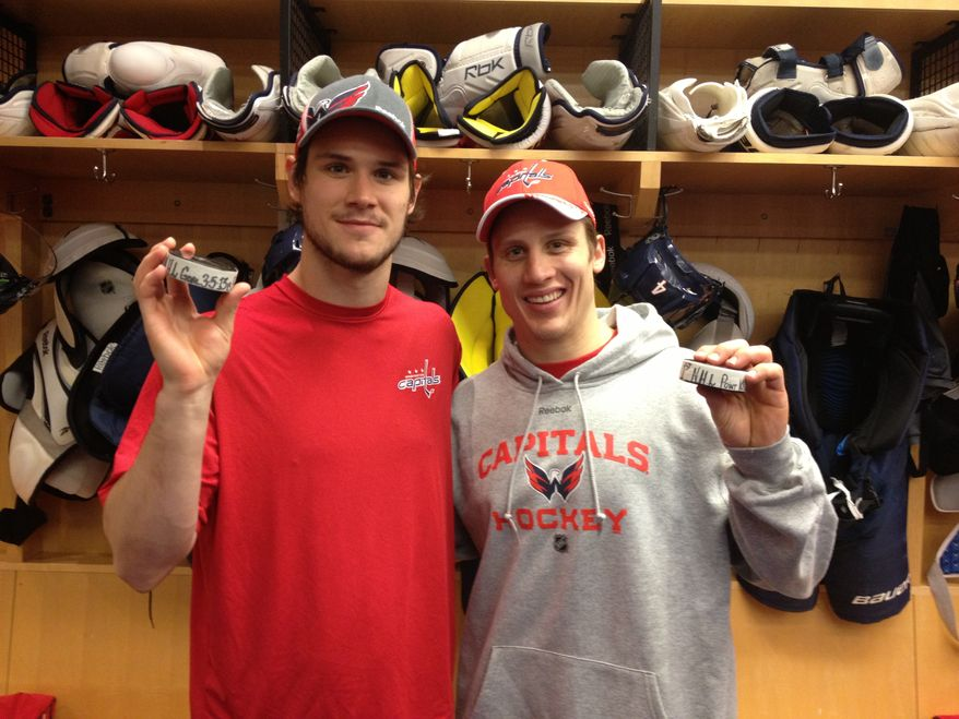 Tomas Kundratek (left, first NHL goal) and Steve Oleksy (first NHL point) celebrated milestones Tuesday night in the Capitals' victory over the Bruins. (Photo courtesy Ben Guerrero / Washington Capitals)