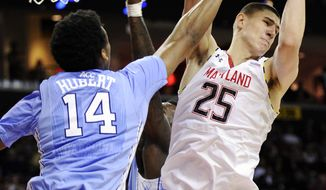 Maryland center Alex Len (25) grabs a rebound against North Carolina forward Desmond Hubert (14) during the first half of an NCAA college basketball game, Wednesday, March 6, 2013, in College Park, Md. (AP Photo/Nick Wass)