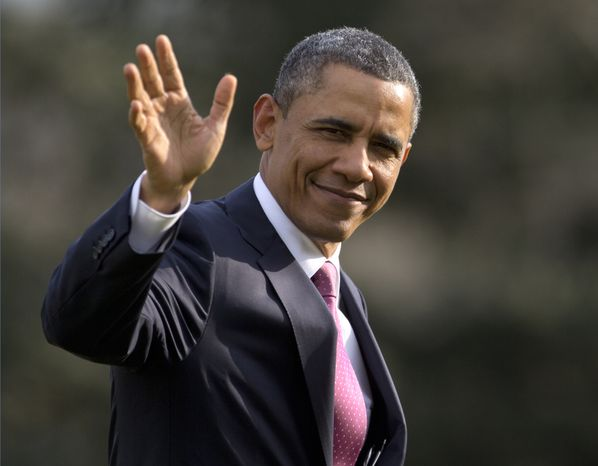 **FILE** President Obama waves to the media as he walks across the South Lawn to the Oval Office of the White House from Marine One in Washington on March 5, 2013. (Associated Press)