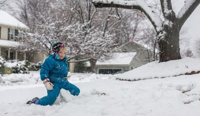 Reily Sweeney, 5, sits on her snowman during a snowball fight in a residential neighborhood, in Fairfax, VA., Wednesday, March 6, 2013.(Andrew S. Geraci/The Washington Times)