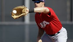 United States' Mark Teixeira catches a throw from the plate during a training session in preparation for the World Baseball Classic on Monday, March 4, 2013 in Scottsdale, Ariz. The United States is scheduled to face Mexico in a first-round game on Friday in Phoenix. (AP Photo/Marcio Jose Sanchez)