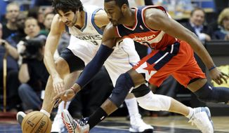 Minnesota Timberwolves' Ricky Rubio, left, of Spain, and Washington Wizards' John Wall chase a loose ball in the first half of an NBA basketball game on Wednesday, March 6, 2013, in Minneapolis. (AP Photo/Jim Mone)