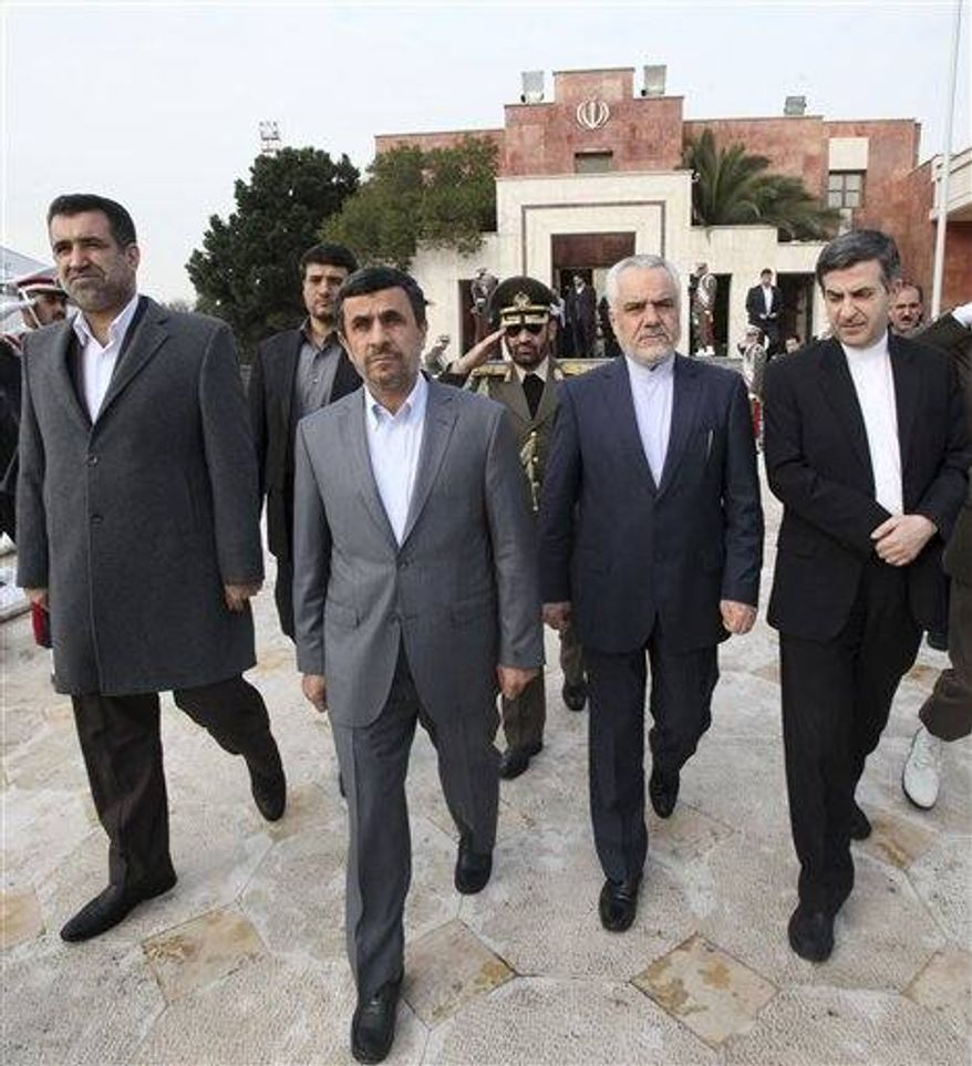 Iranian President Mahmoud Ahmadinejad, second left, leaves Mehrabad airport enrout to Venezuela to attend Hugo Chavez's funeral ceremony, in Tehran, Iran, Thursday, March 7, 2013. Ahmadinejad has left for Caracas to attend the funeral of his Venezuelan ally Hugo Chavez. Ahmadinejad is the head of an Iranian delegation that flew out of Tehran on Thursday. (AP Photo/Vahid Salemi)