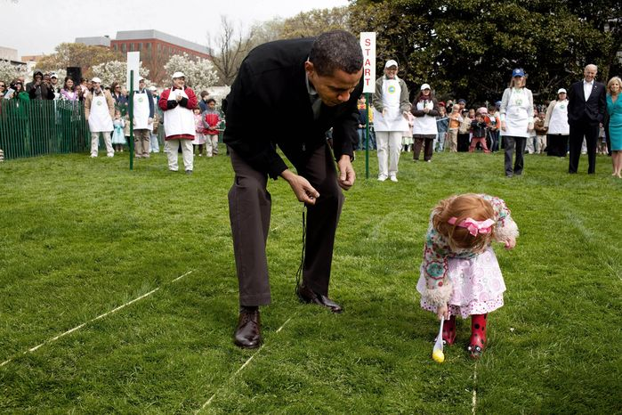 President Obama supervises an Easter egg roll on the White House South Lawn. (credit: Pete Souza)