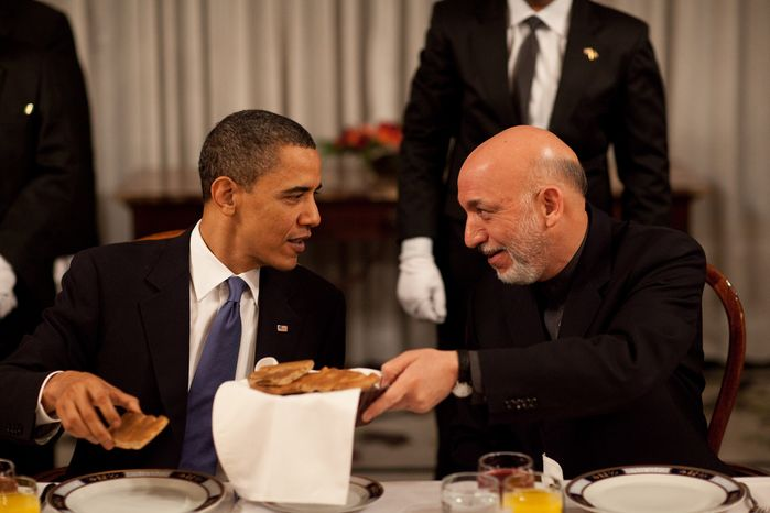 President Hamid Karzai chats with President Barack Obama during the start of the dinner at the Presidential Palace in Kabul, Afghanistan, March 28, 2010. (Official White House Photo by Pete Souza)This official White House photograph is being made available only for publication by news organizations and/or for personal use printing by the subject(s) of the photograph. The photograph may not be manipulated in any way and may not be used in commercial or political materials, advertisements, emails, products, promotions that in any way suggests approval or endorsement of the President, the First Family, or the White House.
