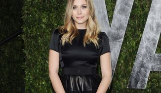 ** FILE ** This Feb. 26, 2012, file photo shows actress Elizabeth Olsen as she arrives at the Vanity Fair Oscar party in West Hollywood, Calif. (AP Photo/Evan Agostini, file)