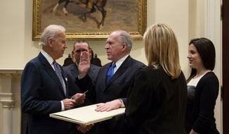 Vice President Joe Biden swears in CIA Director John Brennan in the Roosevelt Room of the White House, March 8, 2013. (White House)
