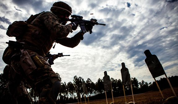 Cpl. Berkeley Lewis, a rifleman with 2nd Reconnaissance Battalion, 2nd Marine Division, fires his M4 carbine during training at the SR-7 range at Marine Corps Base Camp Lejeune, N.C. (Credit: U.S. Marine Corps)