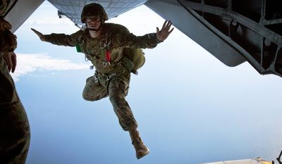 Sgt. Michael Murphy, a reconnaissance Marine with Force Reconnaissance Company, II Marine Expeditionary Force, poses as he jumps out of a CH-53 Super Stallion helicopter Jan. 22. (Credit: U.S. Marine Corps)