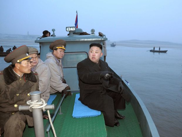 ** FILE ** In this March 7, 2013, photo released by the Korean Central News Agency and distributed March 8, 2013, by the Korea News Service, North Korean leader Kim Jong-un, with military officials, gets a ride on a boat on his way to a military unit on Jangjae Islet, located in the southernmost part of the southwestern sector of North Korea's border