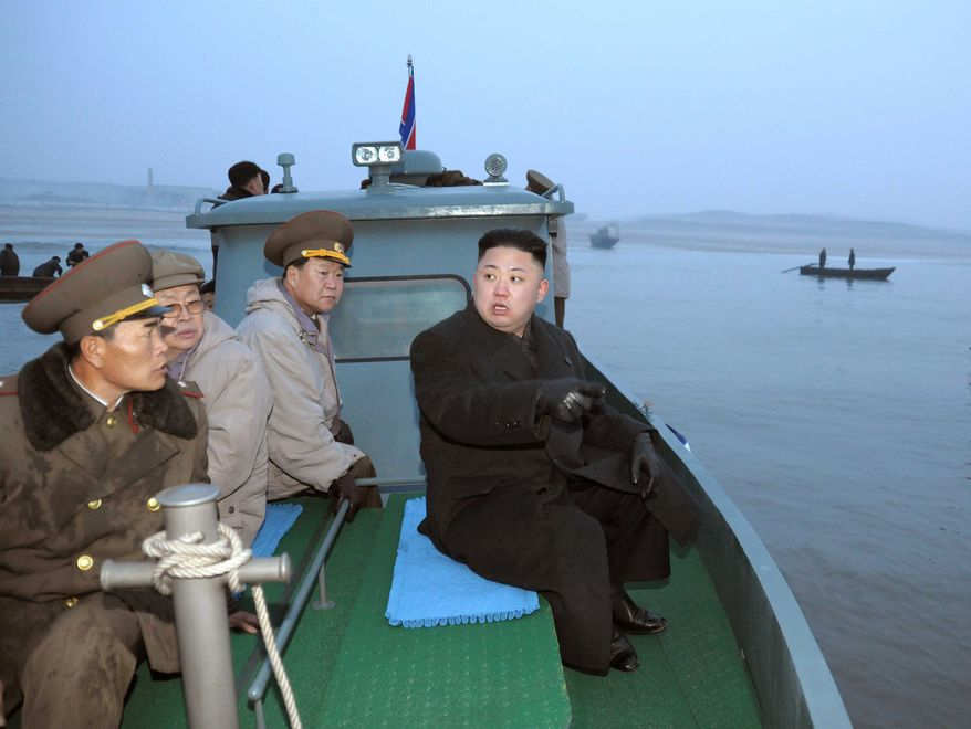 ** FILE ** In this March 7, 2013, photo released by the Korean Central News Agency and distributed March 8, 2013, by the Korea News Service, North Korean leader Kim Jong-un, with military officials, gets a ride on a boat on his way to a military unit on Jangjae Islet, located in the southernmost part of the southwestern sector of North Korea's border with South Korea. (Associated Press/KCNA via KNS)