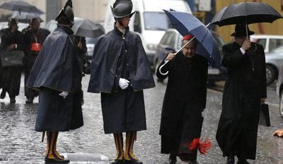 Cardinal Carlo Caffarra, second from right, and Cardinal Raymond Leo Burke, right, walk past two Swiss guards as they leave after a meeting at the Vatican, Friday, March 8, 2013. (AP Photo/Alessandra Tarantino)