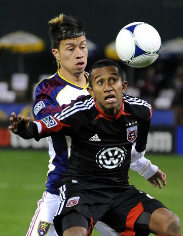 D.C. United midfielder Marcos Sanchez, front, tries to head the ball away from Real Salt Lake midfielder Sebastian Velasquez during the first half of an MLS soccer game, Saturday, March 9, 2013, in Washington. (AP Photo/Richard Lipski)