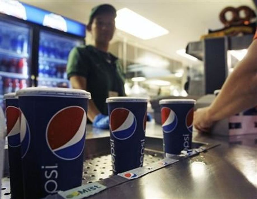 ** File ** Emilio Cordova, right, chooses a soft drink during a baseball game between the New York Mets and the Washington Nationals Wednesday, Sept. 12, 2012, in New York.