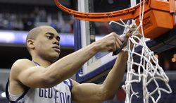 Georgetown guard Markel Starks (5) cuts the net after Georgetown beat Syracuse 61-39 in an NCAA college basketball game to win the Big East Conference regular-season title Saturday, March 9, 2013, in Washington. (AP Photo/Nick Wass)