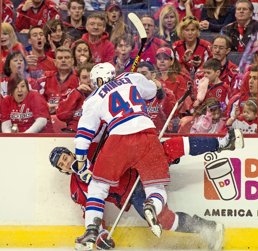 Washington Capitals left wing Aaron Volpatti (24) gets slammed into the wall by New York Rangers defenseman Steve Eminger (44) in the first period as the Washington Capitals play the New York Rangers at the Verizon Center, Washington, D.C., Sunday, March 10, 2013. (Andrew Harnik/The Washington Times)
