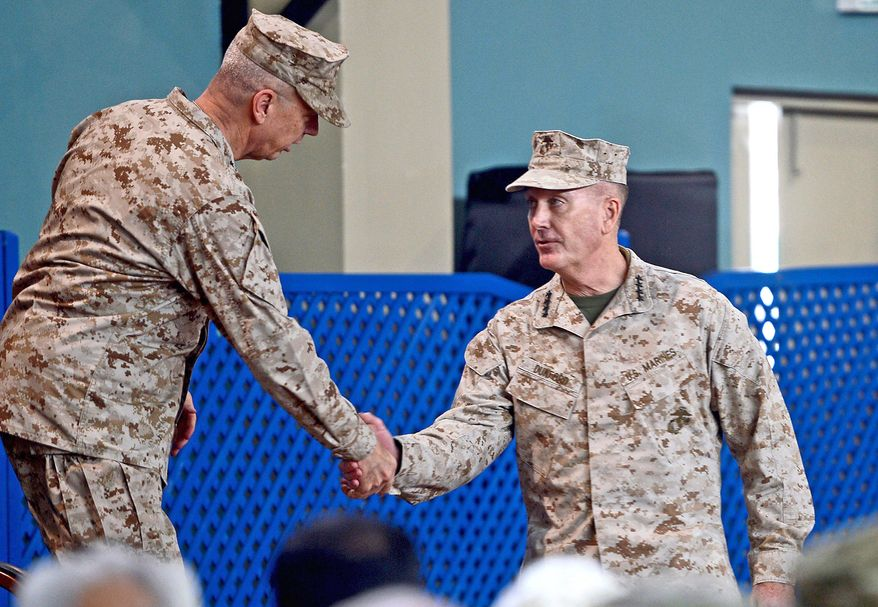 Gen. Joseph F. Dunford, Jr., (right) takes the hand and the command of Gen. John Allen during a February ceremony in Kabul, Afghanistan. Gen. Dunford became the fifth commander of the war in the past five years. (Associated Press)